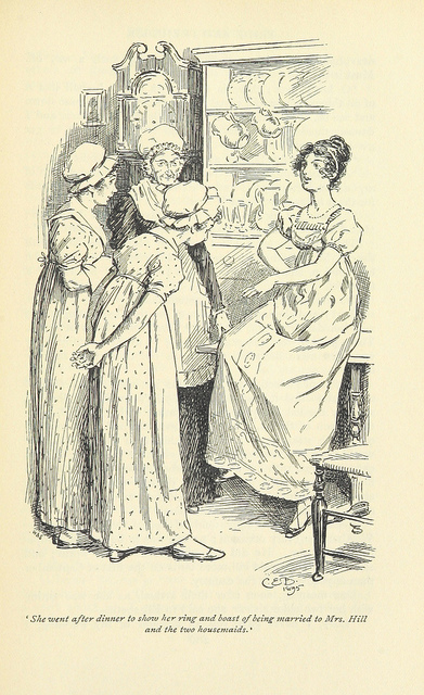 "An illustration from a 19th-century edition of Pride and Prejudice, depicting Lydia showing off her wedding ring to the Bennet's housekeeper Mrs. Hill and two young female servants. Lydia is sitting on the edge of a table and looks pleased with herself. At the bottom of the image is the quote ""She went after dinner to show her ring and boast of being married to Mrs. Hill and the two housemaids."""